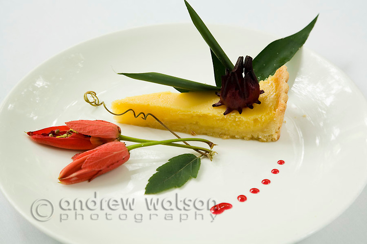 Cheesecake with floral garnish at Daintree Eco Lodge and Spa.  Daintree, Queensland, Australia