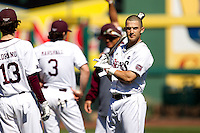 Spiker Helms (9) of the Missouri State Bears warms up with teammates prior to a game against the Southern Illinois University- Edwardsville Cougars at Hammons Field on March 10, 2012 in Springfield, Missouri. (David Welker / Four Seam Images)