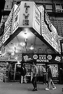 May, 1980. Manhattan, New York City, NY. A cop on the beat outside the Roxy Burlesque sex shop in Times Square featuring &lsquo;live&rsquo; girls: Peep shows, porn theatre and massage parlors are side by side on the Avenue.<br /> <br /> Manhattan, New York City, NY. Mai, 1980. Les &ldquo;salons de massages&ldquo; et les cin&eacute;mas pornographiques XXX sont la grande mine d&rsquo;or de la 42eme rue car ils attirent une foule h&eacute;t&eacute;roclite avide de sensation et qui payent sans discuter les suppl&eacute;ments pour voir des films plus os&eacute;s, en loge priv&eacute;e et en bonne compagnie.