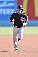 Hickory Crawdads catcher Jose Trevino (7) rounds the bases during game one of a double header against the Asheville Tourists on April 21, 2015 in Asheville, North Carolina. The Crawdads defeated the Tourists 10-1. (Tony Farlow/Four Seam Images)