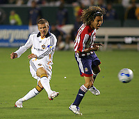 LA Galaxy midfielder David Beckham (23) takes a shot on goal past Chivas midfielder Francisco Mendoza (6). CD Chivas USA defeated the LA Galaxy 3-0 in the Super Classico MLS match at the Home Depot Center in Carson, California, Thursday, August 23, 2007.