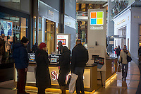 Shoppers at the Microsoft kiosk in the Time Warner Center in New York on Sunday, January 27, 2013. The Surface RT is a rare foray into hardware for Microsoft and is aimed at grabbing market share from Apple's iPad and Google's Android OS. Microsoft is billing Windows 8 as the greatest overhaul of its predominant operating system in 20 years. (© Richard B. Levine)