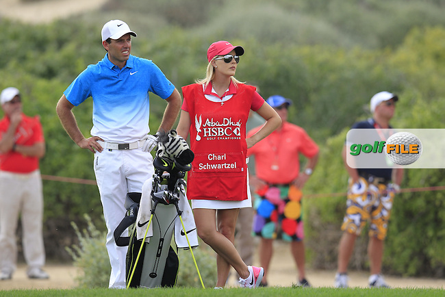 Charl Schwartzel (RSA) and caddy wife Rosalind wait to play his 2nd shot on the 13th hole during Sunday's Final Round of the Abu Dhabi HSBC Golf Championship 2015 held at the Abu Dhabi Golf Course, United Arab Emirates. 18th January 2015.<br /> Picture: Eoin Clarke www.golffile.ie