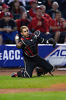 Louisville Cardinals catcher Zeke Pinkham (11) makes a throw to first base against the Notre Dame Fighting Irish in Game Eight of the 2017 ACC Baseball Championship at Louisville Slugger Field on May 25, 2017 in Louisville, Kentucky. The Cardinals defeated the Fighting Irish 10-3. (Brian Westerholt/Four Seam Images)