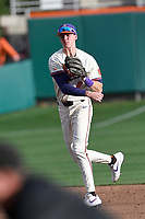 Shortstop Logan Davidson (8) of the Clemson Tigers throws out a runner  in a game against the Charlotte 49ers on Monday, February 18, 2019, at Doug Kingsmore Stadium in Clemson, South Carolina. Clemson won, 7-6. (Tom Priddy/Four Seam Images)