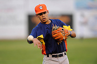 Third baseman Kristian Trompiz (38) of the Greeneville Astros warms up before a game against the Bristol Pirates on Saturday, July 26, 2014, at DeVault Memorial Stadium in Bristol, Virginia. Greeneville won, 4-0 in Game 2 of a doubleheader. (Tom Priddy/Four Seam Images)