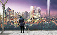 A woman looks at the ad of a development company in Shanghai, China, on January 8, 2009. Photo by Lucas Schifres/Pictobank