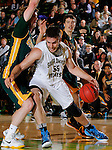 NOVEMBER 17, 2014 -- Andrew Rebol #55 of South Dakota Mines drives past Black Hills State defenders during their college men's basketball game Monday evening at the Donald E. Young Center in Spearfish, S.D.  (Photo by Dick Carlson/Inertia)
