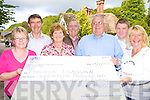 Gneeveguilla AC presents the cheque of EUR17,400 to their lotto winner Maureen Donovan Headford, Killarney in Killarney Wednesday morning l-r: Joan Warren, Joe Donovan, Maureen Donovan, Paddy, Tom Joe O'Donoghue, Aidan O'Sullivan and Mary O'Sullivan