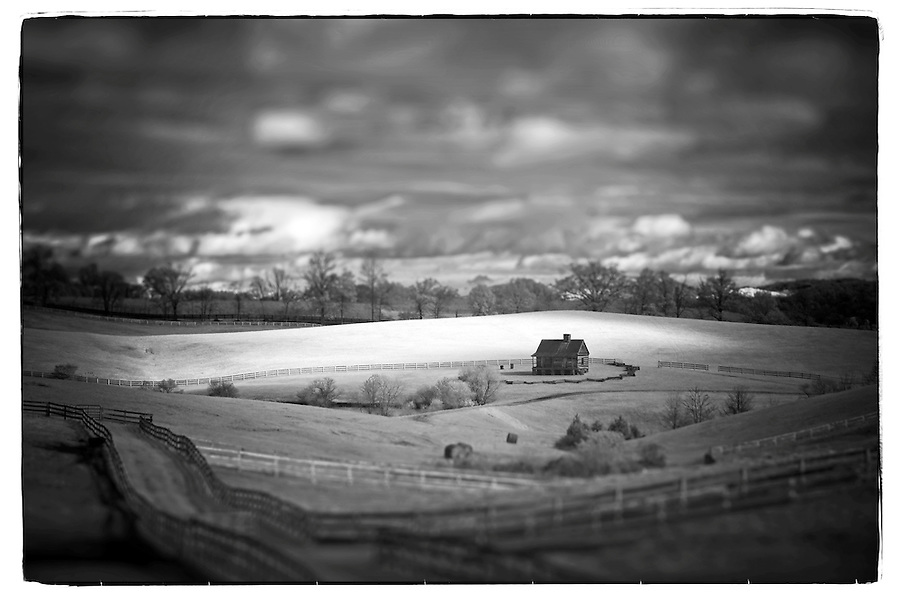 An infrared tilt-shift view of a log cabin alone in a field of fences in Crozet, VA. . Photo/Andrew Shurtleff