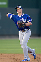 Oklahoma City Dodgers shortstop Corey Seager (18) makes a throw to first base during the Pacific Coast League baseball game against the Round Rock Express on June 9, 2015 at the Dell Diamond in Round Rock, Texas. The Dodgers defeated the Express 6-3. (Andrew Woolley/Four Seam Images)