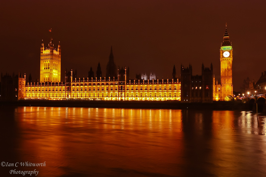 View at night across the River Thames in London at the Palace of Westminster