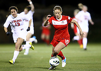 BOYDS, MARYLAND - April 06, 2013:  Caroline Miller (10) of The Washington Spirit races away from Molly Menchel (13) of the University of Virginia women's soccer team in a NWSL (National Women's Soccer League) pre season exhibition game at Maryland Soccerplex in Boyds, Maryland on April 06. Virginia won 6-3.