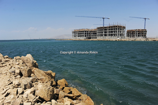 Some of the first buildings are seen under development at the Khazar Islands project near Sahil, Azerbaijan on July 18, 2012.  The brainchild of Ibrahim Ibrahimov, an Azerbaijani oligarch and billionaire, the artificial Khazar Islands project just southwest of the Azerbaijani capital Baku is being built at a projected cost of $100 billion with an anticipated 800,000 housing units.