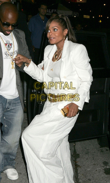 JREMAINE DUPRI & JANET JACKSON.Celebrates her 40th birthday with a party held at Shag Nighclub, Hollywood, California, USA..May 16th, 2006.Photo: Russ Elliot/AdMedia/Capital Pictures.Ref: RE/ADM.full length white skirt jacket holding hands.www.capitalpictures.com.sales@capitalpictures.com.© Capital Pictures.