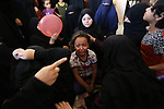 Relatives of Palestinian Abdul Karim Radwan, who was killed in an Israeli air strike, mourn during his funeral in Rafah in the southern of Gaza Strip on July 20, 2018. Photo by Ashraf Amra