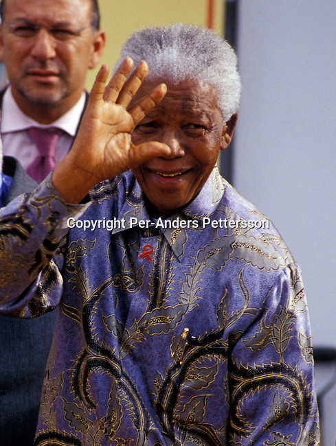 "CAPE TOWN, SOUTH AFRICA - FEBRUARY 11: Former president Nelson Mandela arrives at a ceremony on February 11, 2004 in Cape Town, South Africa. Mr. Mandela attended a ceremony celebrating the first newly built houses in District Six, as colored people were forced away during the sixties to make way for white residents during the Apartheid era. The area is now in the process of being re-constructed and some of the surviving people are soon to move in. Nelson Mandela retired in 1999 and now heads the ""Nelson Mandela Children's Fund"", a foundation supporting projects involving children in South Africa. .(Photo: Per-Anders Pettersson/ iAfrika Photos......."