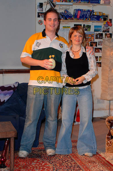 "PATRICK HARVEY & SARAH McGLADE .""The Vegemite Tales"" photocall at the Venue Theatre, London, UK..August 31st, 2006.Ref: CAN.full length jeans denim black yellow rugby top.www.capitalpictures.com.sales@capitalpictures.com.©Can Nguyen/Capital Pictures"