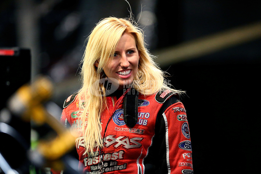 May 30, 2014; Englishtown, NJ, USA; NHRA funny car driver Courtney Force during qualifying for the Summernationals at Raceway Park. Mandatory Credit: Mark J. Rebilas-