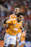 Houston Dynamo midfielder Dwayne De Rosario (14) celebrates his 47th minute goal with Houston Dynamo defender Wade Barrett (24).   Houston Dynamo beat CSD Municipal 3-1 at Robertson Stadium in Houston, TX March 19, 2008 in the second leg of the first round of the CONCACAF Champion's Cup.  The Houston Dynamo win the series with a 3-1 aggregate over CSD Municipal.