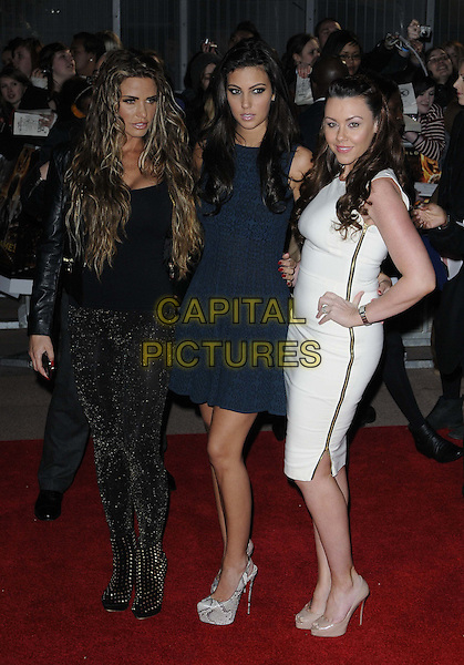 Katie Price (Jordan), Ellie Jenas, Michelle Heaton.European Premiere of 'The Hunger Games' at Cineworld at the O2 Arena, London, England..March 14th 2012.full length black white blue dress sparkly leggings zip zipper hand on hip.CAP/CAN.©Can Nguyen/Capital Pictures.