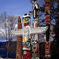 Totem Poles at Brockton Point in Stanley Park, Vancouver, British Columbia, Canada, in Spring.  From left to right: Nisga'a (Nishga) - called Beaver Crest Pole; Kwakwaka'wakw (Kwakiutl) - called Thunderbird House Post, with Thunderbird sitting above Grizzly Bear; Kwakwaka'wakw (Kwakiutl) - called Chief Wakas Pole; and Nuu-Chah-Nulth - called Sky Chief Pole.