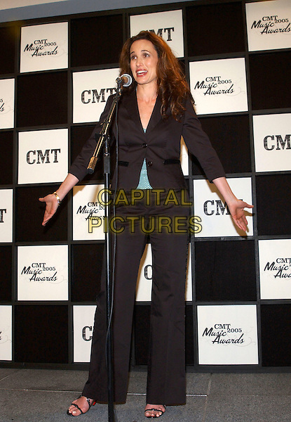 ANDIE MacDOWELL.2005 CMT Music Awards held at the Gaylord Entertainment Center, Nashville, Tennessee, USA, .11 April 2005..full length funny arms out gesture hands andy mcdowell.Ref: ADM.www.capitalpictures.com.sales@capitalpictures.com.©George Shepherd/AdMedia/Capital Pictures.