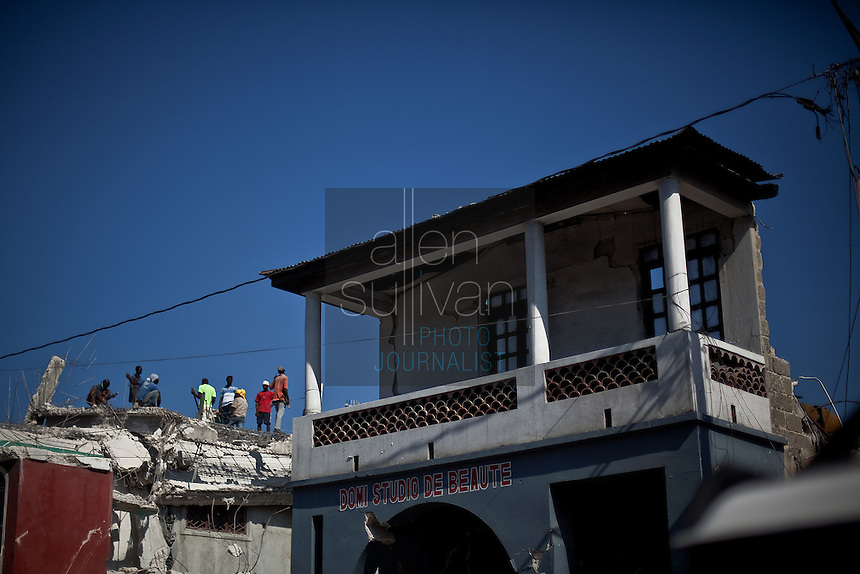Men atop a collapsed structure in Port-au-Prince. The 7.0 earthquake that devastated parts of Haiti on January 12 killed hundreds of thousands of people. January's earthquake killed hundreds of thousands of people and caused significant and lasting structural and economic damage in the Caribbean nation.