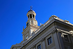 Looking up at tower and blue sky of Ayuntamiento city hall building, Cadiz, Spain