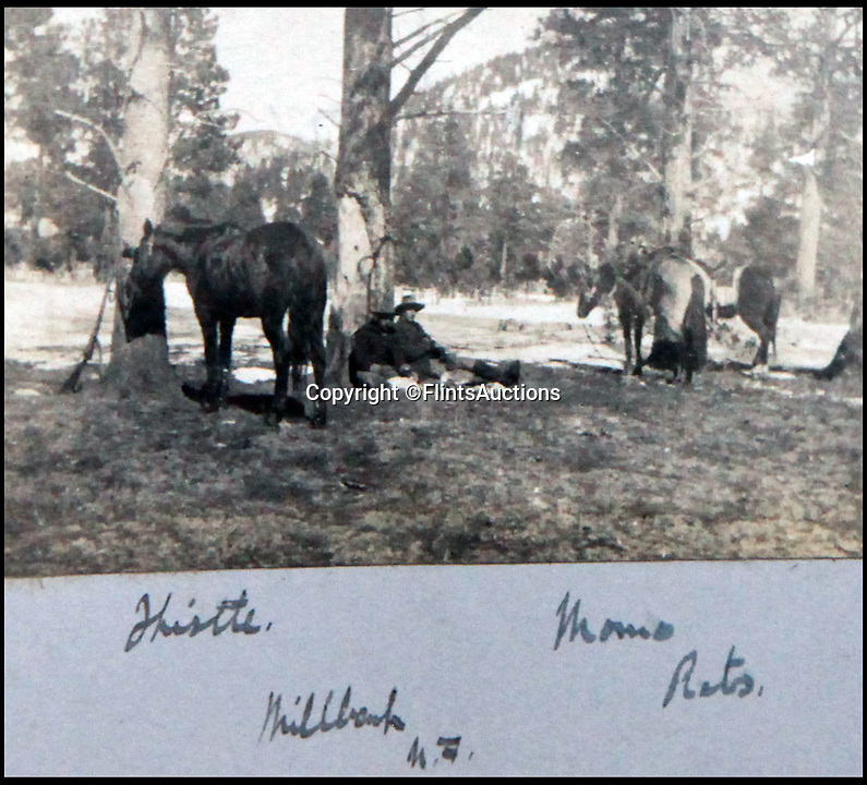 BNPS.co.uk (01202 558833)<br /> Pic: FlintsAuctions/BNPS<br /> <br /> Resting with horses.<br /> <br /> Unseen album reveals the life of a cowboy in the real wild west...<br /> <br /> Fascinating previously unseen early photos of cowboys in the Wild West have come to light 130 years later.<br /> <br /> They show life on the ranches of Colorado and New Mexico in the vast expanses of the south west US in the 1880s.<br /> <br /> One dramatic image captures the thrilling moment a group of cowboys ride towards the camera with hats held aloft.<br /> <br /> The photos are thought to have been taken by a British farmhand who travelled Stateside in the late 19th century to earn a living.