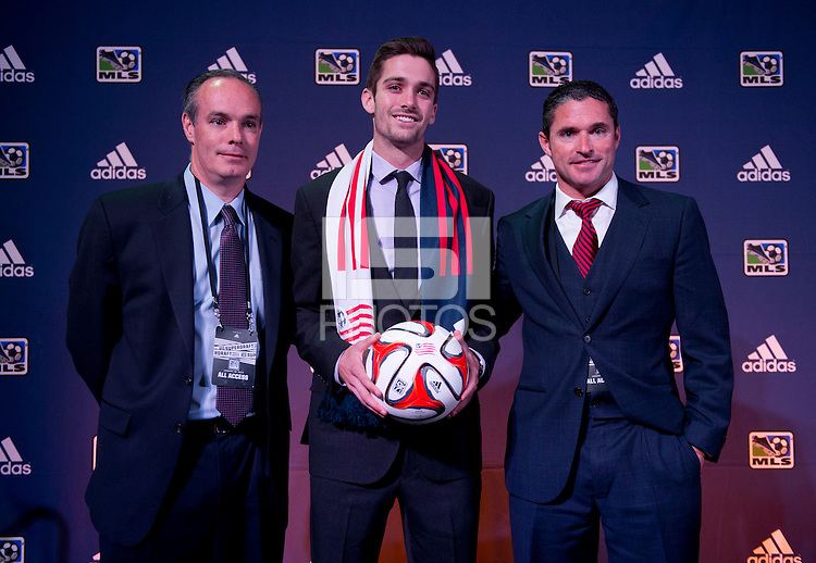 #4 overall pick Steve Neumann of the New England Revolution stands with head coach Jay Heaps (right) during the MLS SuperDraft at the Pennsylvania Convention Center in Philadelphia, PA, on January 16, 2014.