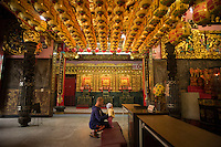 A man prays with his baby at the Temple of Lady Linshui, who is the the Patron Saint of children, in Tainan, Taiwan, 2015.