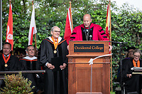 Conferring of Honorary Degree and Response - Jonathan Veitch, President and John G. Power '58, Trustee.<br /> Families, friends, faculty, staff and distinguished guests celebrate the class of 2019 during Occidental College's 137th Commencement ceremony on Sunday, May 19, 2019 in the Remsen Bird Hillside Theater.<br /> (Photo by Marc Campos, Occidental College Photographer)