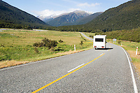 motorhome driving on empty road through mountains, New Zealand