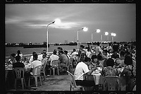 Chinese diners enjoy their seafood meals along the Pearl River in Shatian, Dongguan, Guangdong province, August 2016.