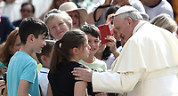 Papa Francesco saluta dei bambini al suo arrivo all'udienza generale del mercoledi' in Piazza San Pietro, Citta' del Vaticano, 6 giugno, 2018.<br /> Pope Francis greets children as he arrives to lead his weekly general audience in St. Peter's Square at the Vatican, on June 6, 2018.<br /> UPDATE IMAGES PRESS/Isabella Bonotto<br /> <br /> STRICTLY ONLY FOR EDITORIAL USEUPDATE