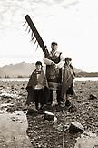 USA, Alaska, Sitka, Sheeta Kwan Naa Kahidi dancers in traditional costume, Nathan Howard with his son Jonathan and daughter Alice, Sitka Sound