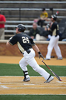 Gavin Sheets (24) of the Wake Forest Demon Deacons follows through on his swing against the Miami Hurricanes at Wake Forest Baseball Park on March 22, 2015 in Winston-Salem, North Carolina.  The Demon Deacons defeated the Hurricanes 10-4.  (Brian Westerholt/Four Seam Images)