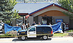 Officials investigate the scene of a shooting in an IHOP restaurant in Carson City, Nev., on Tuesday, Sept. 6, 2011. (AP Photo/Cathleen Allison)