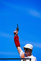 Man, with Raised Arm, holding Starter Pistol in Air at Starting Line - On Your Mark, Get Set, Go