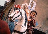 Cairo, Egypt, a boy on a homemade merry-go-round.
