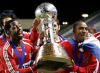 Chicago Fire defender Dasan Robinson (32, left) and Chicago Fire forward Andy Herron (26, right) parade the Dewar Cup around the stadium.  The Chicago Fire defeated the Los Angeles Galaxy 3-1 in the championship game of the U.S. Open Cup at Toyota Park in Bridgeview, IL on September 27, 2006...