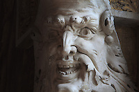 Head of a laughing satyr in carved stucco from the frame of the Danae fresco panels by Rosso Fiorentino, 1535-37, in the Galerie Francois I, begun 1528, the first great gallery in France and the origination of the Renaissance style in France, Chateau de Fontainebleau, France. The Palace of Fontainebleau is one of the largest French royal palaces and was begun in the early 16th century for Francois I. It was listed as a UNESCO World Heritage Site in 1981. Picture by Manuel Cohen