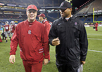 SEATTLE, WA - September 28, 2013: Stanford head coach David Shaw, right walks off the field with honorary captain after a game against Washington State at CenturyLink Field. Stanford won 55-17