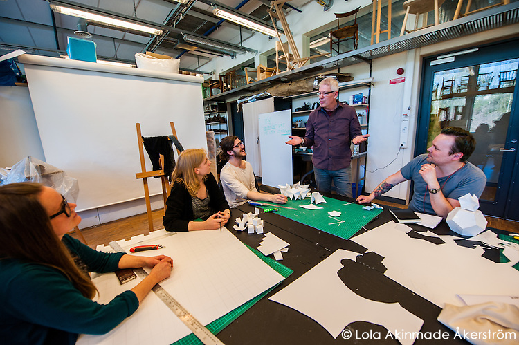 Furniture design professor Leó Jóhannsson instructing final-year design students.