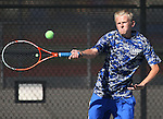 Taylor Saarem with the Carson High boys tennis plays Reno at CHS, in Carson City, Nev., on Monday, Sept. 15, 2014.<br /> Photo by Cathleen Allison