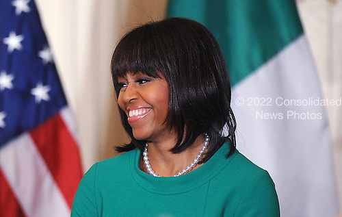 First lady Michelle Obama smiles during a reception for Ireland's prime minister in the East Room of the White House in Washington, D.C., March 19, 2013 in Washington, DC. <br /> Credit: Olivier Douliery / Pool via CNP