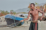A year after Hurricane Matthew ravaged parts of Haiti, a man prepares his nets for fishing off the coast of northwestern Haiti near the village of Plateforme. The village was ravaged in the storm, and Lutheran World Relief, a member of the ACT Alliance, has helped the community rebuild its economy with fishing materials, a solar-powered refrigerator room for storing their catch, and other assistance.