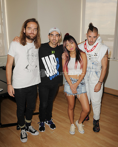 HOLLYWOOD, FL - JUNE 11: Jack Lawless, Cole Whittle, Joe Jonas, JinJoo Lee of DNCE visit radio station Hits 97.3 on June 11, 2016 in Hollywood, Florida. Credit: mpi04/MediaPunch