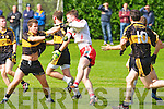 Currow's Padraig O'Shea tries to stop An Ghaeltacht Padraig Og O Se in the intermediate championship at Currow on Sunday.